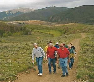 Residents of Summit County, Colorado walk trails on the county landfill property as part of effort manage motorized use in the area.