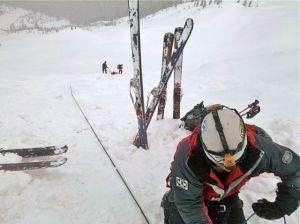 Search and Rescue workers lower an avalanche victim from Peak 2 in the Tenmile Range in Summit County, Colorado.