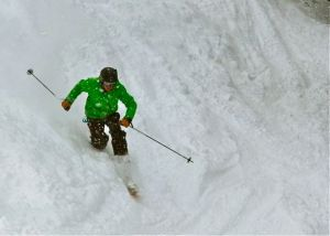 A telemark skier enjoys some late-season powder at Arapahoe Basin.