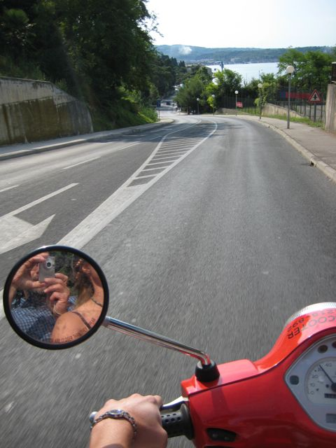 Moped riding in Piran, Slovenia.