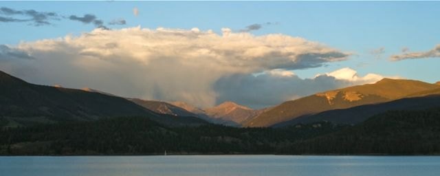 A classic anvil-headed cumulunimbus cloud drops showers just east of the Continental Divide near Grays and Torreys Peak Tuesday evening. We haven't had a chance to see these beautiful clouds recently because we've been right underneath them. Click on the image to learn more about thundercloud formation.