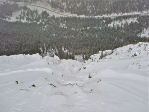 A view looking down from the top of the first Steep Gully, a popular sidecountry area near A-Basin where a snowboarder died in avalanche last winter. Highway 6 is visible far below. PHOTO COURTESY CAIC.