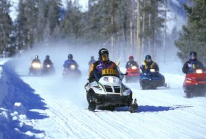 Snowmobile use in National Parks is strictly managed, like this tour in Yellowstone, but in some national forests, more management is needed to protect the environment and make sure there are opportunities for quiet, non-motorized use.