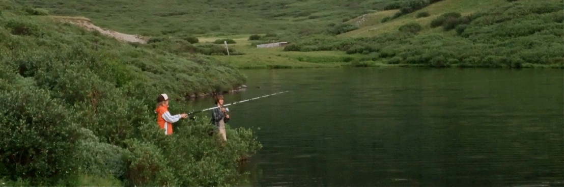 Fishing for cutthroat trout at Clinton Gulch Reservoir, Summit County, Colorado.