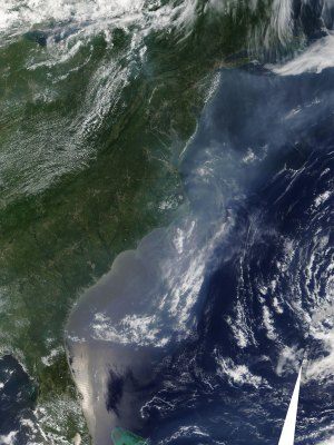 A NASA satellite image shows air pollution along the East Coast and over the Atlantic.