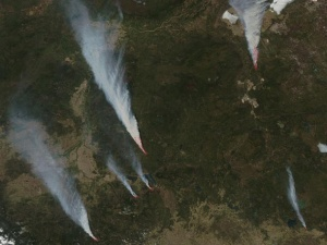 A NASA satellite image shows smoke plumes from the massive wildfires in Alberta.