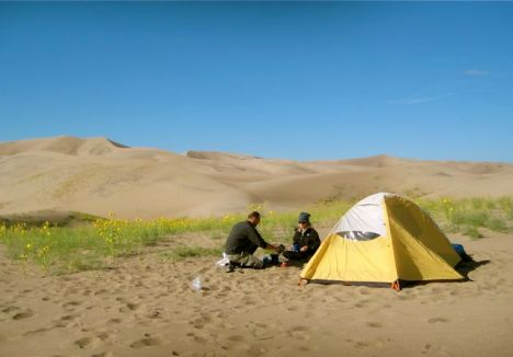 Camping in the backcountry wilderness of Great Sand Dunes National Park. Click on the image to visit the park website.