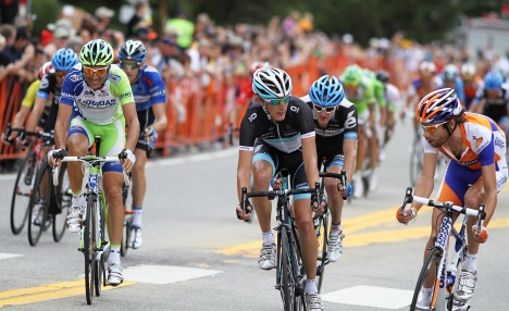 Ivan Basso, Andy Schleck, Tom Peterson and Laurens Ten Dam, the breakaway leaders, are caught by the peloton just as they race down Park Avenue towards the finish line on Main Street. PHOTO BY JENNEY COBERLY.
