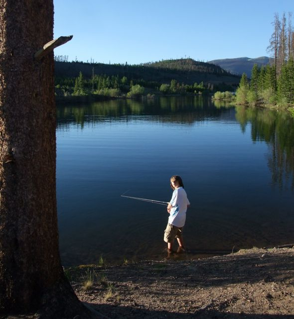 "Fishing in glassy water at a ""hidden"" cove along the shore of Dillon Reservoir."