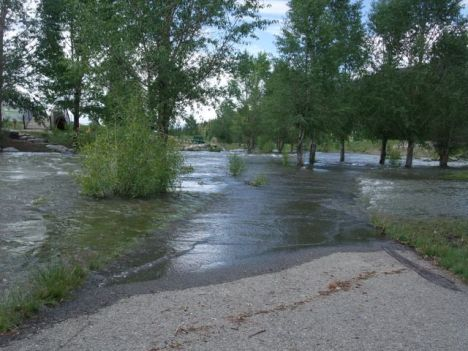 Last year, an excess, as the Blue River ran at flood stage July 8 near the town rec center. This year, not enough, as the town council considers water restrictions. PHOTO BY BOB BERWYN.