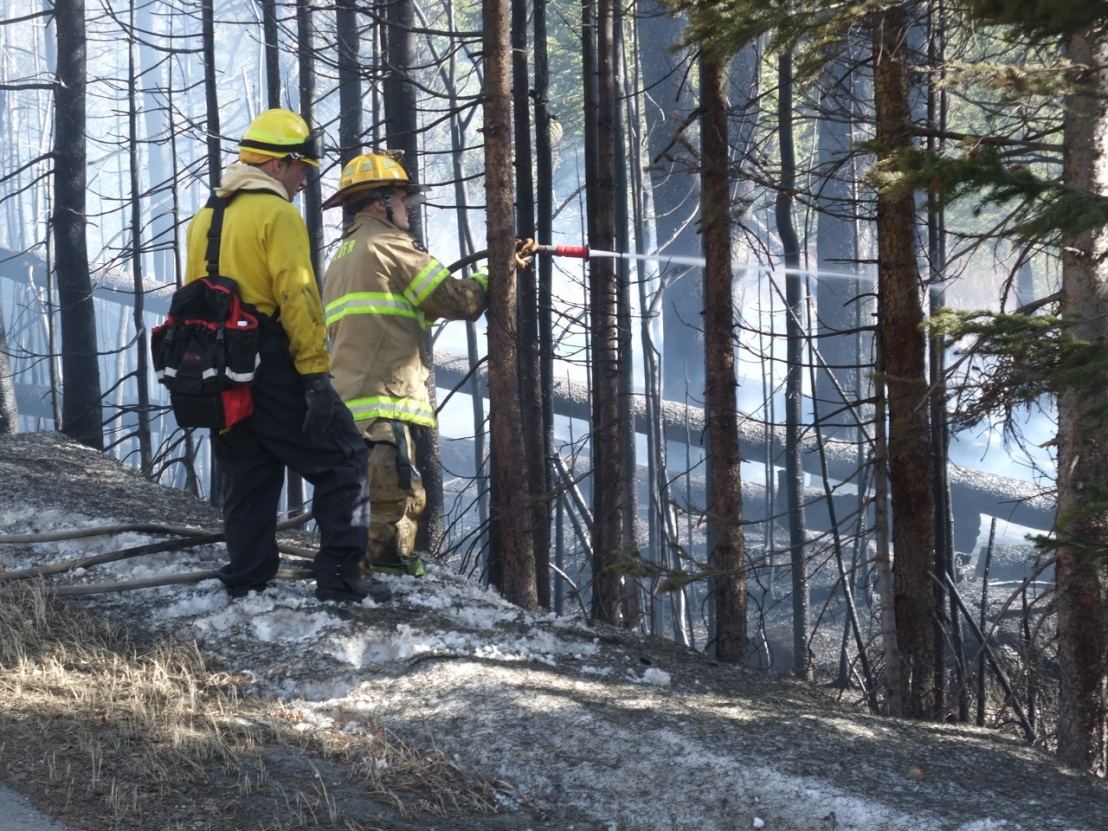 Summit County firefighters extinguish a small wildfire between Keystone and Montezuma late March, 2012.