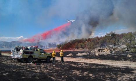 A slurry drop at the Pine Ridge Fire. Photo courtesy Brian Borjon/InciWeb.