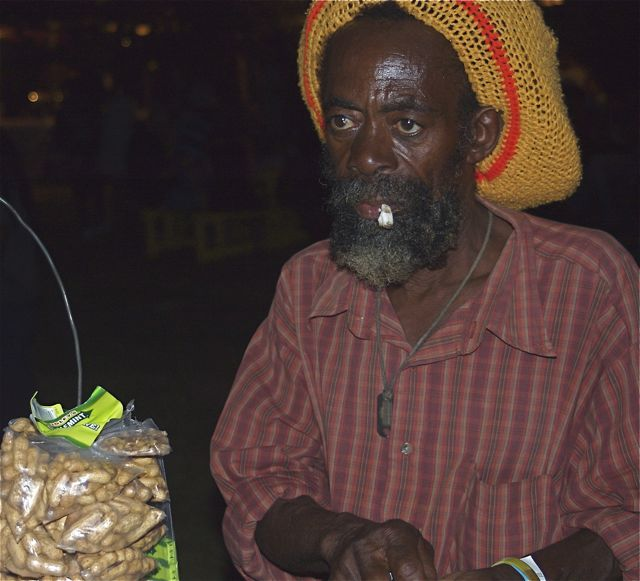 What can you read in this peanut vendor's face, spotted at the All-Jamaica Jerk Festival at Three Dives in Negril's West End?