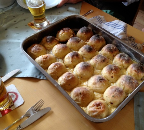 Speckknödel - Only the Austrians could come up with a bacon-filled dumpling served with bacon pan drippings.
