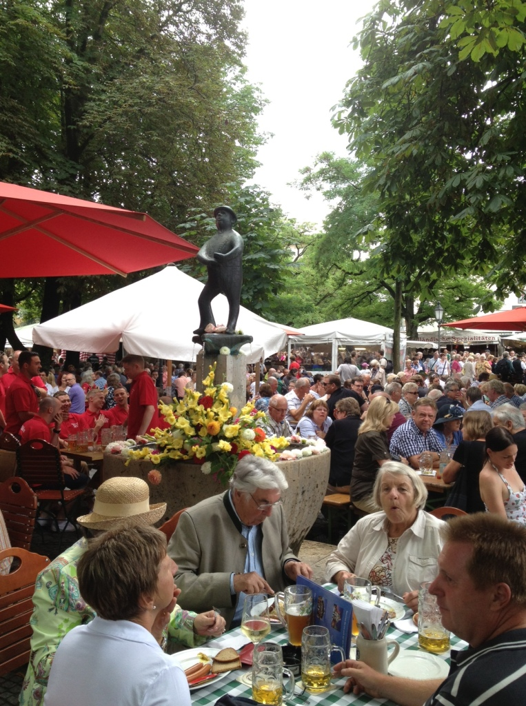 Tourists and locals throng the Viktualienmarkt in Munich, Germany.