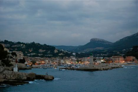 Dusk falls over the harbor of Cassis, France.