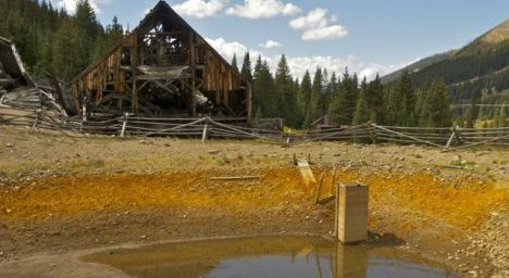 Pollution from mining can affect ground and surface water for many decades, like here at the abandoned Pennsylvania Mine site in Summit County, Colorado, where miles of stream have poisoned by acid mine drainage. Photo by Bob Berwyn.