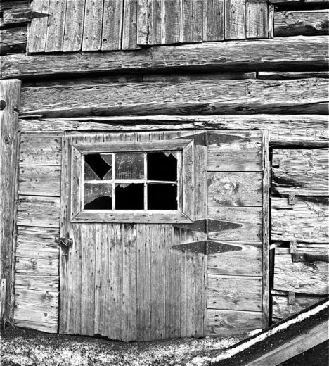 Broken window in an old ranch cabin, Glenwood Springs, Colorado.