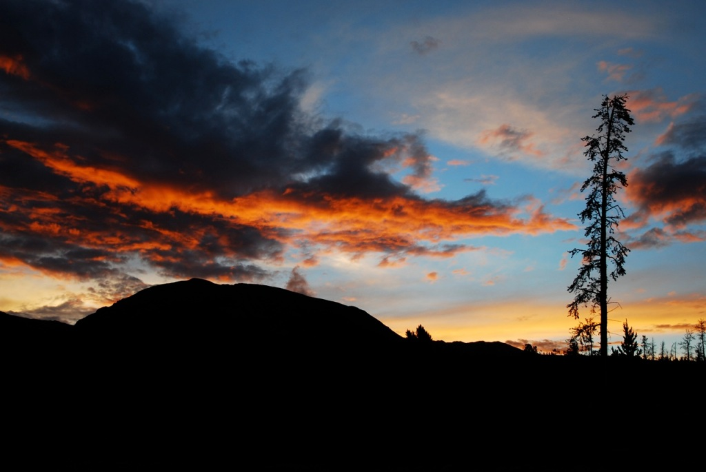 Buffalo Mountain silhouette against a fiery sunset.