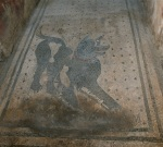 An old (some say the original) beware of dog sign, part of  Roman mosaic in Pompeii.