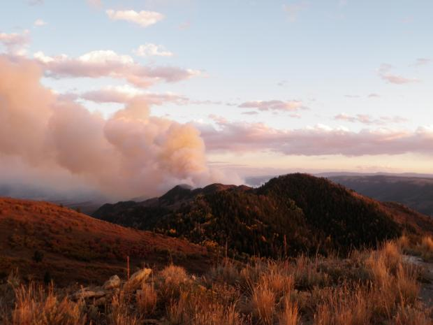 Smoke from the Highway 13 fire rises above the Grand hogback, near Rifle, Colorado. Photo courtesy Inciweb.