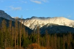 First light hits the high peaks of the Gore Range after a dusting of snow.