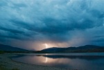 Lightning over the Continental Divide. This was on the night before we left on a three-week Europe family trip. When the sky started rumbling, I left my packing (which only takes about 20 minutes, anyway) and rushed down to Heaton Bay in hopes of getting a lighting shot.