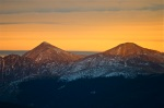 A wave cloud makes a stunning sunset backdrop for Gray and Torreys peaks, two fourteeners along the Continental Divide in Summit County, Colorado.