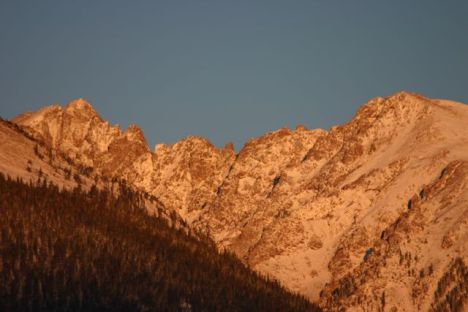 Morning alpenglow paints the Gore Range in Summit County, Colorado.