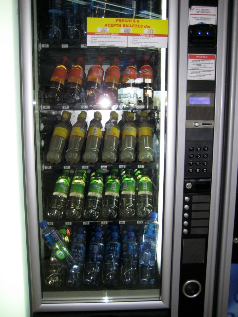 We never did figure the secret of this vending machine at the Buenos Aires airport. All we know is, it kept swallowing our money without ever dispensing the cold drink we sought.