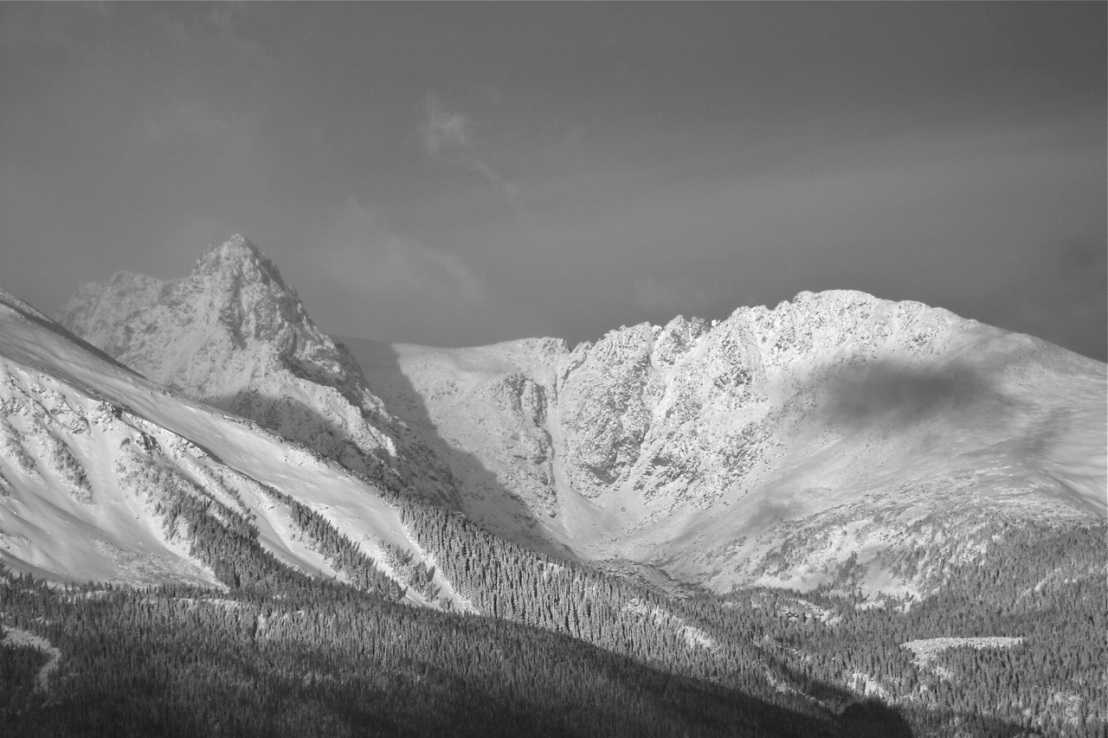 A classic black and white mountain and snow scene.