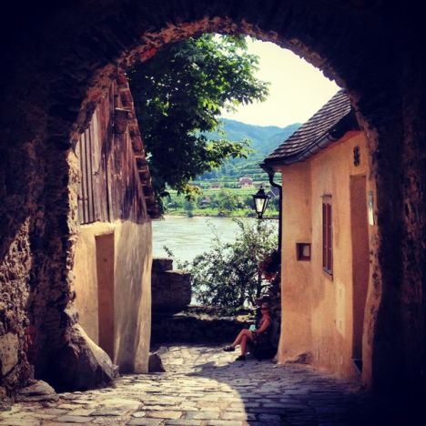 The shadow of this ancient stone archway in Dürnstein, Austria, creates a pleasing frame for this summer scene along the Danube River.