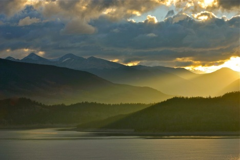 Autumn sunlight slants over Dillon Reservoir, in Summit County, Colorado.