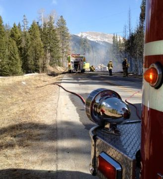 Local firefighters teamed up in March 2012 to quell an early season wildfire along Montezuma Road, near Keystone Resort, in Summit County, Colorado. Bob Berwyn photo.