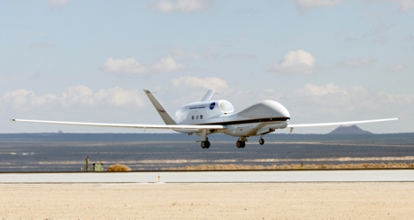 NASA Global Hawk No. 872 flares for landing at Edwards Air Force Base, Calif. The autonomously operated unmanned research aircraft will be flying at high altitude over the Pacific Ocean during the ATTREX environmental science mission. (NASA/Jim Ross