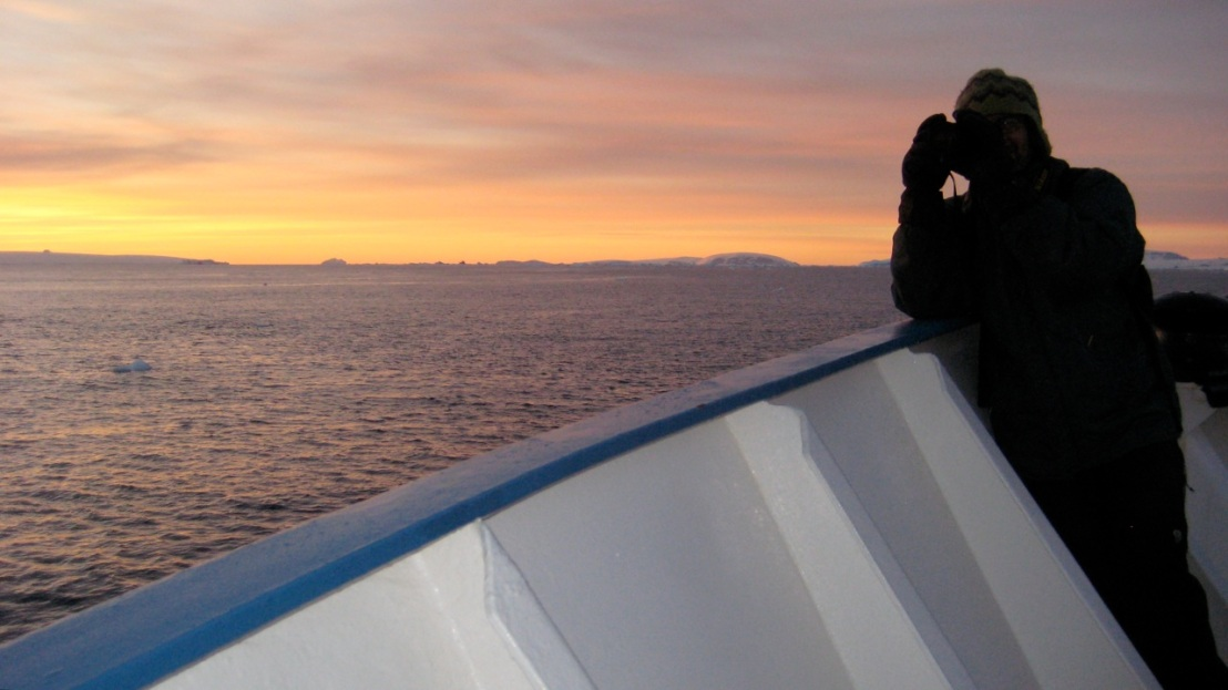 Bob Berwyn enjoying a sunrise view from the deck of the M/V Professor Molchanon in the Antarctic Sound.