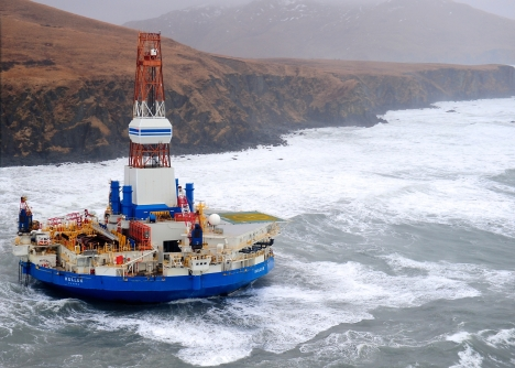 The conical drilling unit Kulluk sits aground on the southeast shore of Sitkalidak Island about 40 miles southwest of Kodiak City, Alaska, in 40 mph winds and 20-foot seas Tuesday, Jan. 1, 2013. The Kulluk grounded following many efforts by tug and Coast Guard crews to tow the vessel to a safe harbor when it was beset by winter storm weather during a tow from Dutch Harbor, Alaska, to Everett, Wash. U.S. Coast Guard photo by Petty Officer 1st Class Sara Francis.