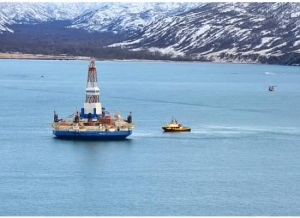The anchor-handling vessel, the Aiviq, tows the drilling unit Kulluk to a safe harbor location in Kiliuda Bay, Alaska on Jan. 7, 2013. Photo by U.S. Coast Guard Petty Officer 3rd Class Jonathan Klingenberg.
