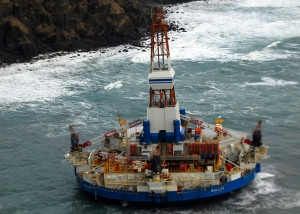 The conical drilling unit Kulluk sits grounded 40 miles southwest of Kodiak City, Thursday, Jan. 3, 2012. The Kulluk grounded after many efforts by tug vessel crews and Coast Guard crews to move the vessel to safe harbor during a winter storm. U.S. Coast Guard photo by Petty Officer 2nd Class Zachary Painter.