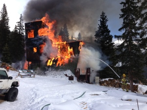 "Firefighters from Lake Dillon and Red, White & Blue fire departments battle a blaze at a landmark home in Montezuma known as the ""Tiltin' Hilton."" The house was completely destroyed. Credit: Lt. Scott Vinas, Lake Dillon Fire-Rescue"