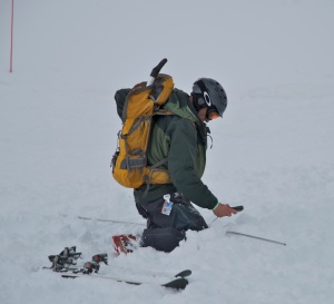 A contestant in the 2012 Beacon Bowl at A-Basin zeroes in on a buried beacon.