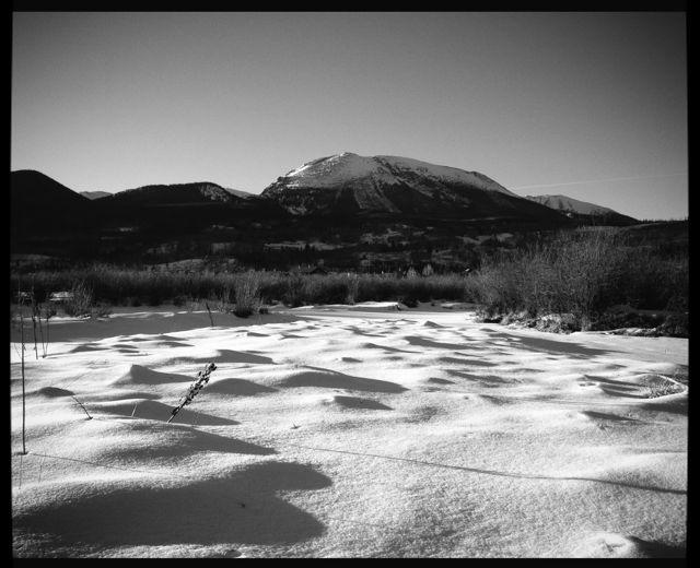 Snow dunes in Frisco, Colorado, with Buffalo Mountain as a backdrop.