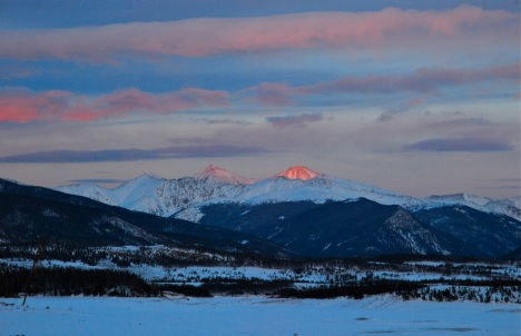 Alpenglow kisses the highest peaks of the Continental Divide in Summit County, Colorado.