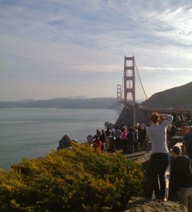 Tourists take photos at the Golden Gate Bridge overlook in Marin County, California.