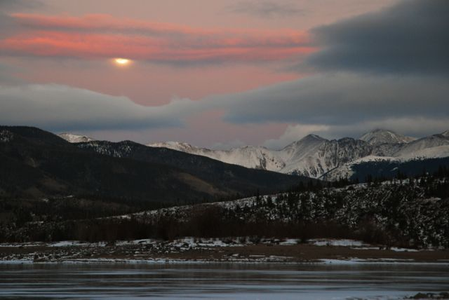A December full moon rises over the Continental Divide.