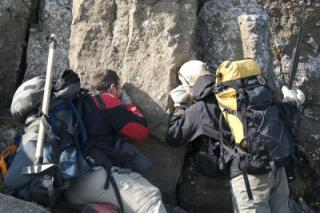 UBC geologists examine pyroclastic deposits near summit of tephra cone on south side of Kima'Kho. Key attributes of these deposits established that they were deposited above the level of a surrounding englacial lake.
