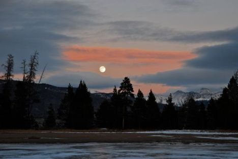 A winter full moon rising over Grays and Torreys, two 14ers along the Continental Divide in Summit County, Colorado.