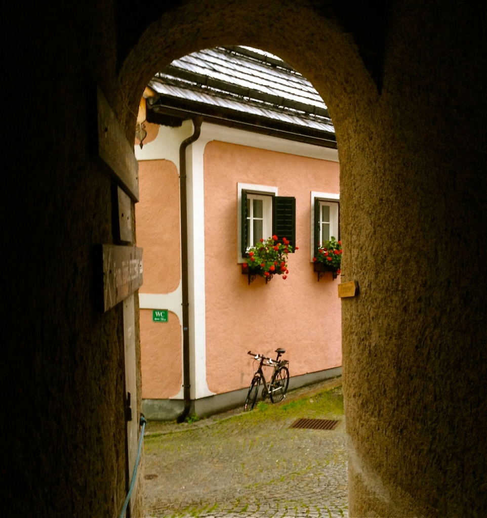 An arched opening in a thick stone wall in Hallstatt, Austria provides cover from a summer thunderstorm.