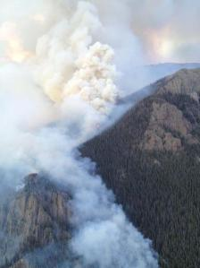 A smoke column rises from the West Fork Fire Complex in Colorado's San Juan Mountains. Photo courtesy InciWeb/Schlapfer