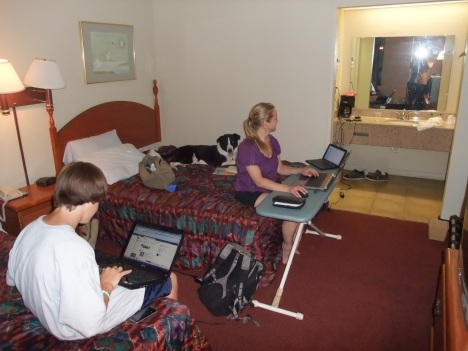 Motel room becomes impromptu office/social media center during a road trip. Pretty sure that's a dog on the bed (Shhh, don't tell).